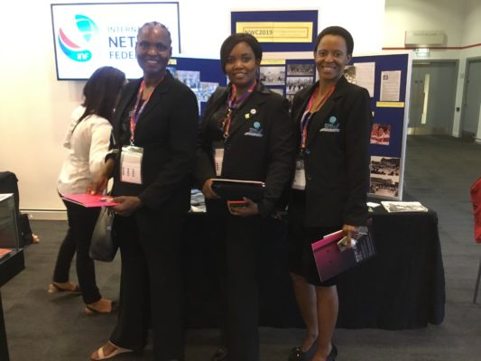 England Heritage display at INF Congress.  Delegates from Barbados