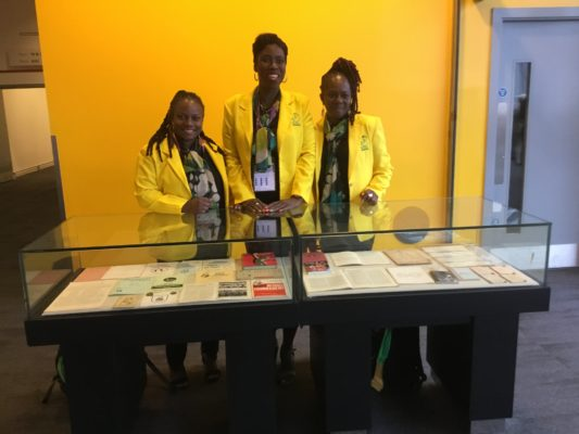 England Heritage display at INF Congress.  Delegates from Jamaica