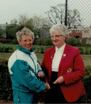 Les Jones, OPA coach, receiving her Long Service Award from Pat Taylor