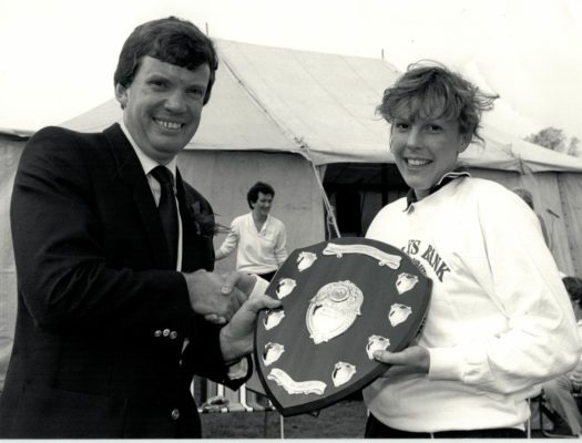 Liz Horley, Captain Henley College U21 winners receiving the Barclays National Tournament Perpetual Challenge Shield from Mike Lumsden, Assistant Local Director.