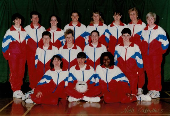 1993 England Squad for Tour of Jamaica. Back row left to right:  Jane Read (Umpire), Liz Broomhead (Coach), Sam Bird, Lucia Sdao, Sharon Fogarty, Pat Sweeney, Joyce Wheeler (Manager), Patsy Rochester (Physio). Middle row: Sally Young, Tracy Bartrum, Leigh McManus, Lisa Topliss. Front row:  Fiona Murtagh, Kendra Lowe (Captain), Maggie Farrell | Neils Carruthers
