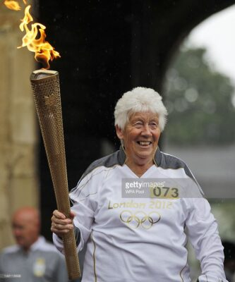 Gina and the Olympic Torch | Getty Images