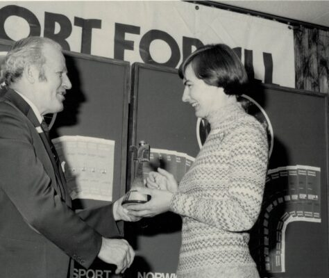 Mr Walter Winterbottom, Director of the Sports Council, presenting Anne Miles with her Sport for All trophy for the Women over 25 years category in the Service to Sport Awards 1976.