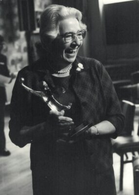 Mary Bullock with her statuette as a retiring gift from being Editor of the Netball Magazine for many years.