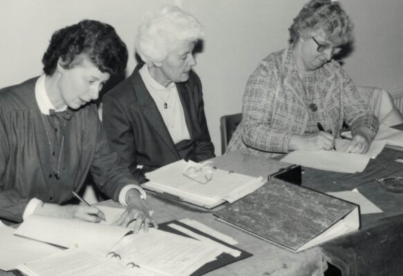 This historic moment for the AENA is when it signed over its assets to AENA Ltd.  From left to right:  Annette Cairncross, President, Pat Taylor, Chairman, and Mary Thomas, Vice Chairman