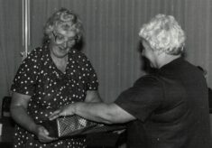 1986 Pat Taylor receiving her present as retiring from Chairman of the National Executive from Lily McGurk