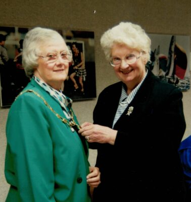 At the 1994 AGM in February, Pat Taylor, retiring President, handed over the Chain of Office to the new President, Jean Bourne.