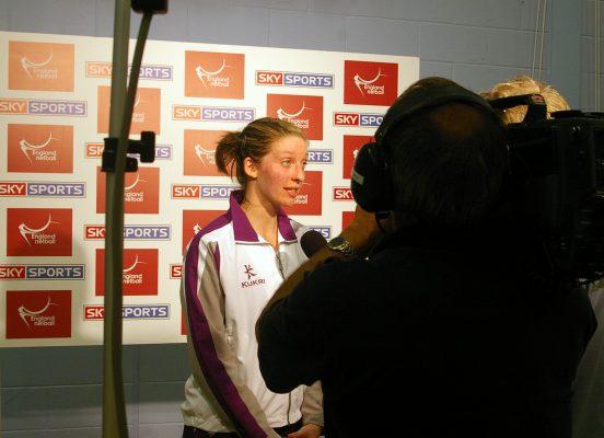Olivia Newton being interviewed
