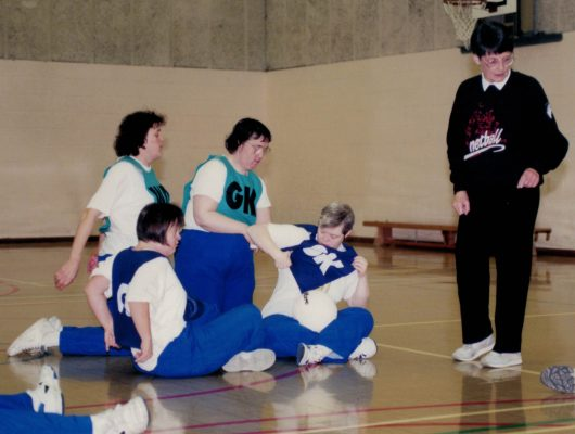 Jean Perkins, lead coach, getting the players ready for a game.