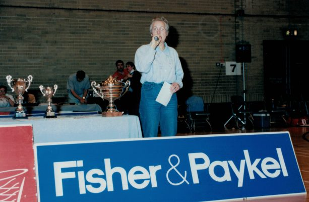 Janet Wrighton announcing the results with the winners and runners up trophies, plus the Player of the Tournament trophy