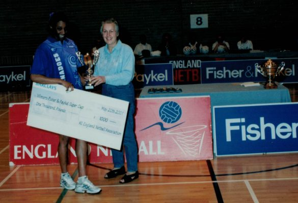 Janet Wrighton presenting the winners trophy and cheque to Petchy London Tornadoes