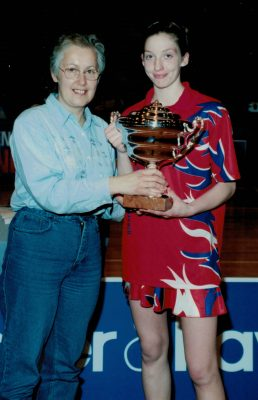 Janet Wrighton presenting Olivia Murphy with the Player of the Tournament Trophy.