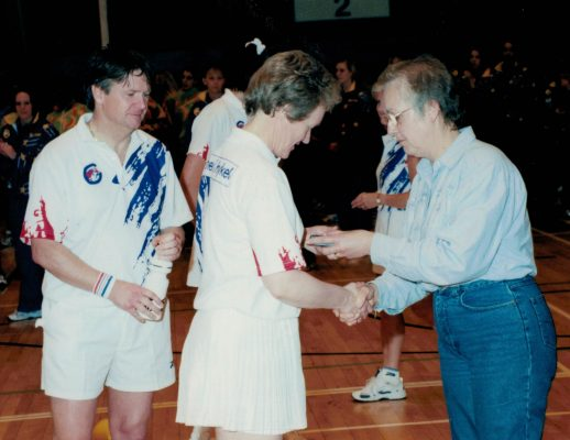 Margaret Deighan receiving the Umpires medal from Janet Wrighton, President, with Bill Alexander next in line.